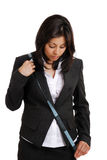 Business woman using a measuring tape looking down Royalty Free Stock Photos