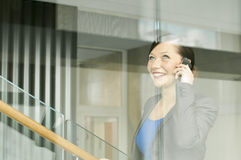 Business woman using a mobile phone. At the office Stock Images