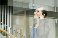 Business woman using a mobile phone. At the office Royalty Free Stock Photography