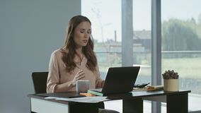 Business woman using mobile phone. Concentrated freelancer talking phone. stock video