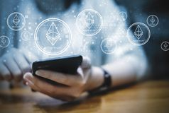 Business woman using mobile phone with cryptocurrency ethereum Royalty Free Stock Photos