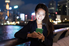 Business woman using mobile phone at night Royalty Free Stock Image