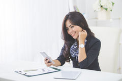 Business woman using mobile phone Stock Photo