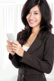 Business woman using mobile phone Stock Photos