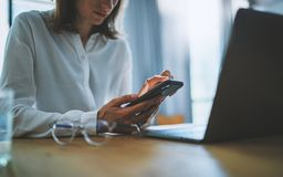 Business woman using mobile phone at working day in office.Blurred background. Business Technology Communications stock photos