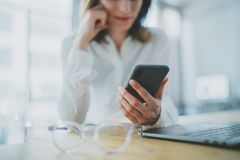 Business woman using mobile phone at working day in office.Blurred background. Business Technology Communications royalty free stock photos