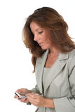 Business Woman Using PDA 3. Attractive business woman using a pda, personal data assistant, handheld computing device Royalty Free Stock Photography