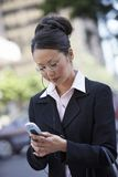 Business Woman Using Phone. Successful business woman using cell phone Royalty Free Stock Image