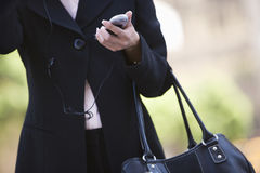 Business Woman Using Phone. Mid section of mature businesswoman using cell phone Stock Image
