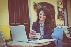 Business woman using smart phone. Young woman typing on mobile Stock Photos
