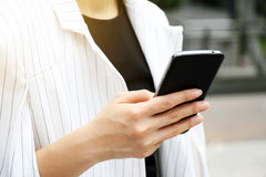 Business woman using a smart phone. stock images