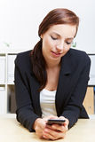 Business woman using smartphone Stock Image
