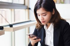 Business woman using smartphone checking e-mail, message today. Concept people and technology. royalty free stock photography