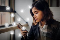 Business woman using smartphone connecting people with digital. Worldwide. Concept business strategy plan stock photography