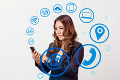 Business woman using smartphone and icon Royalty Free Stock Photography
