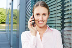 Business woman using smartphone Royalty Free Stock Photos