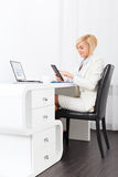 Business woman using tablet bright ofice desk Royalty Free Stock Photos