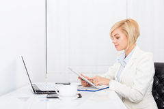 Business woman using tablet bright ofice desk Stock Photography