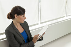Business woman using a tablet computer Stock Photo