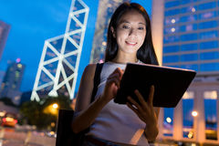 Business woman using tablet computer in Hong Kong city Royalty Free Stock Images