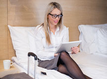 Business woman using tablet computer in hotel room Stock Photos