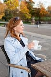 Business woman using tablet on lunch break. Royalty Free Stock Image