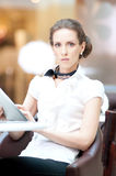 Business woman using tablet on lunch break in cafe Royalty Free Stock Photos
