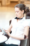 Business woman using tablet on lunch break in cafe Royalty Free Stock Images