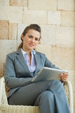 Business woman using tablet PC Stock Image