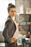 Business woman using tablet pc in loft apartment Stock Image