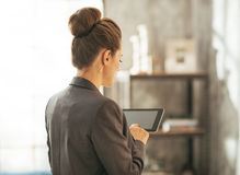 Business woman using tablet pc in loft apartment Royalty Free Stock Photo