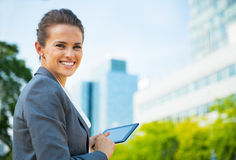 Business woman using tablet pc in office district Royalty Free Stock Photos