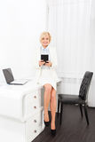 Business woman using tablet sitting office desk Stock Photography