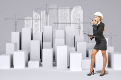Business woman using walkie-talkie. Many white Royalty Free Stock Photography