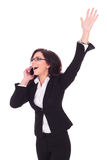 Business woman victorious on phone Stock Images