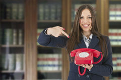 Business woman. With vintage red phone Stock Image