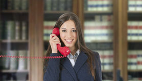 Business woman. With vintage red phone Stock Photo