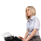 Business woman with vintage typing machine Stock Images