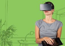 Business woman in virtual reality headset with tablet against green hand drawn office Stock Photography
