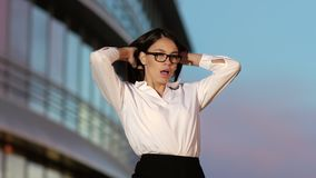 Business woman vulgar dancing by the office building. stock video footage