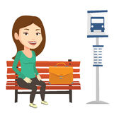 Business woman waiting at the bus stop. Royalty Free Stock Photos