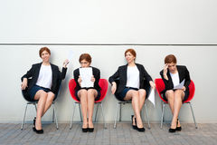 Business woman waiting for interview. Same person in all roles Royalty Free Stock Photo