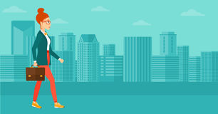 Business woman walking with briefcase. A woman walking with a briefcase on the background of modern city vector flat design illustration. Horizontal layout Royalty Free Stock Images