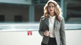 Confident business woman is walking along the modern business center. the manager is in a hurry to meet with clients or. Business woman walking on business stock video