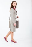 Business woman walking with case Royalty Free Stock Photos