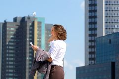 Business woman walking in the city with mobile phone Stock Photo
