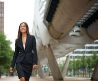 Business woman walking in the city Stock Image