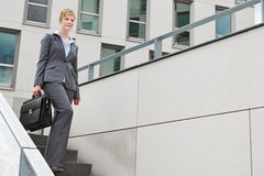 Business woman walking down stairs Stock Image