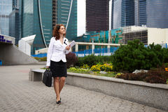 Business woman walking down the street Royalty Free Stock Images