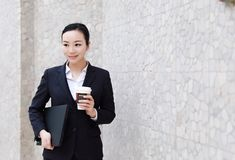 Business woman walking drinking coffee and Notebook computer. Business woman walking drinking coffee. Lawyer professional or similar walking outdoors happy royalty free stock photography